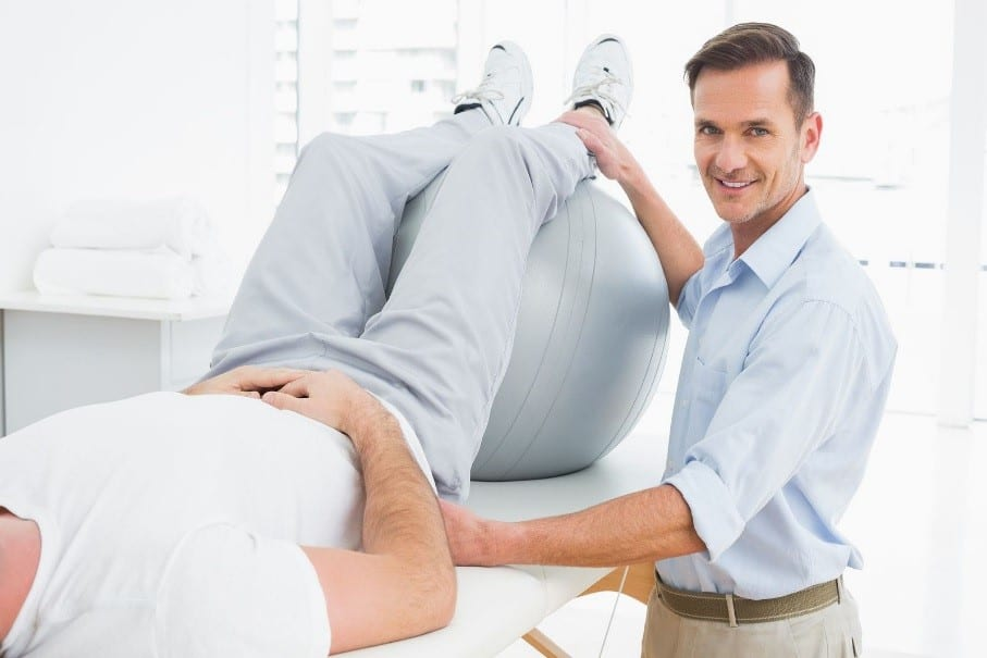 A Chiropractor Conducting a Physical Therapy Session in His Practice